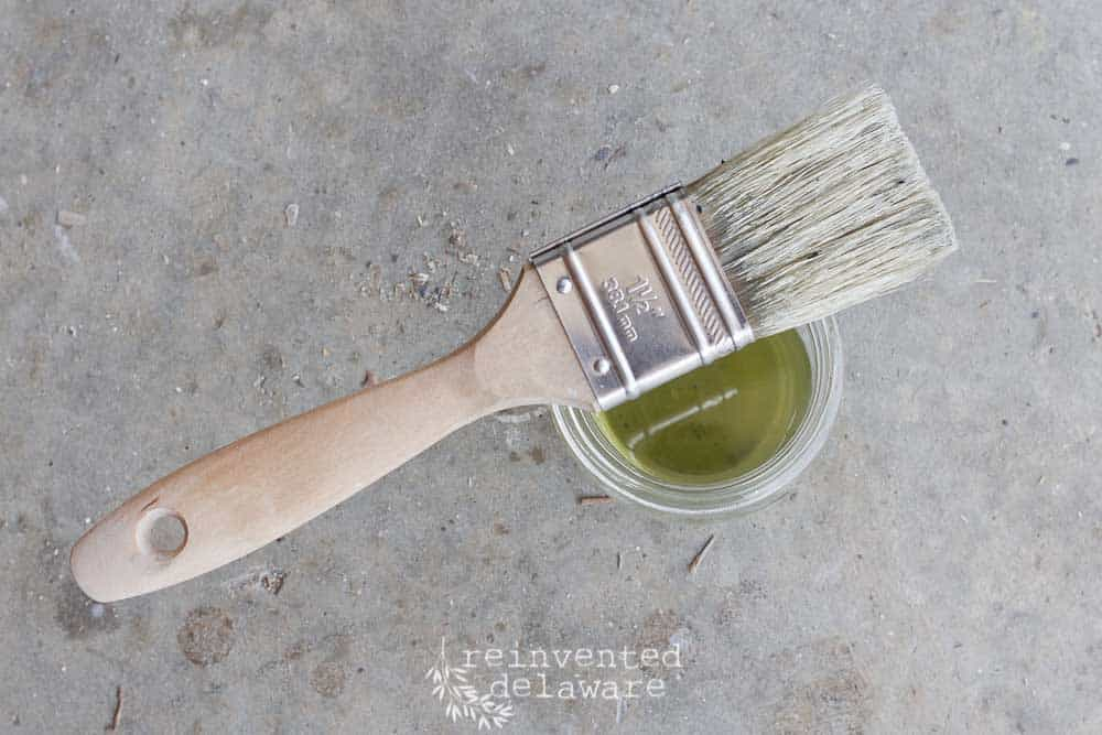 paint brush and hemp oil in jar