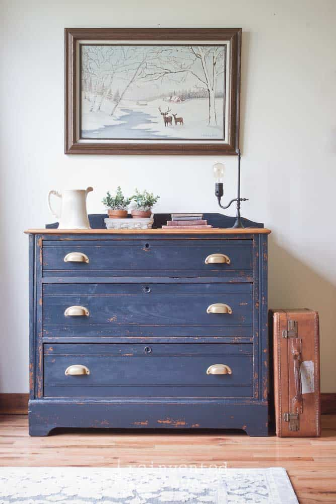 front view of Miss Mustard Seed milk painted antique dresser with various items on top
