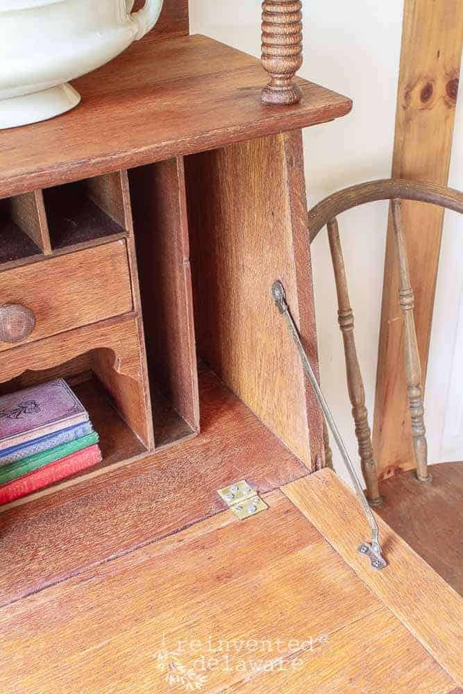restored vintage side by side secretary desk close up of hinge