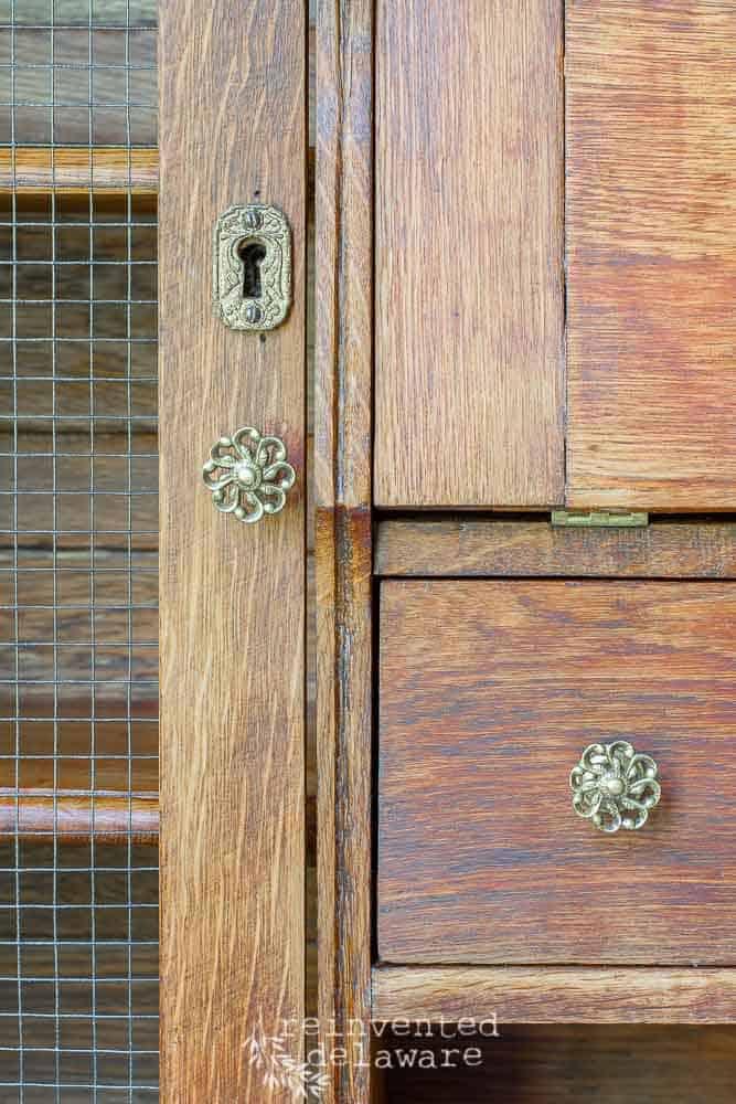 restored vintage side by side secretary desk close up of hardware and keyhole