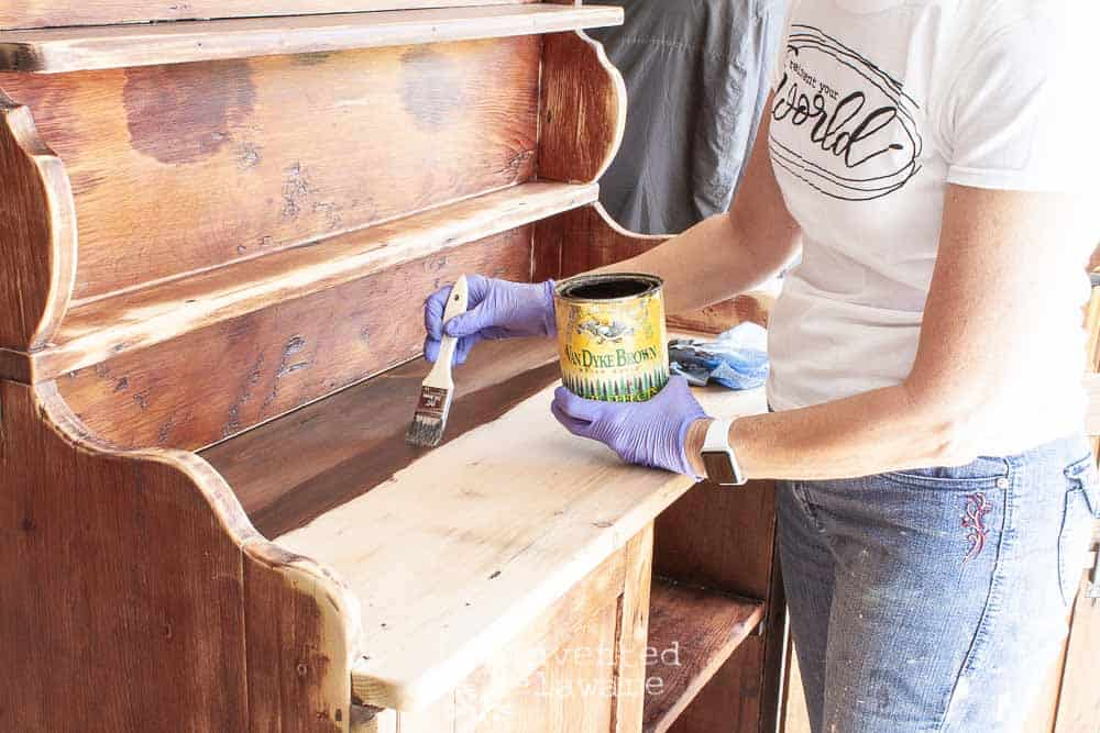 staining top of antique pine cupboard with General Finishes Van Dyke Brown Glaze as an idea for milk paint furniture ideas