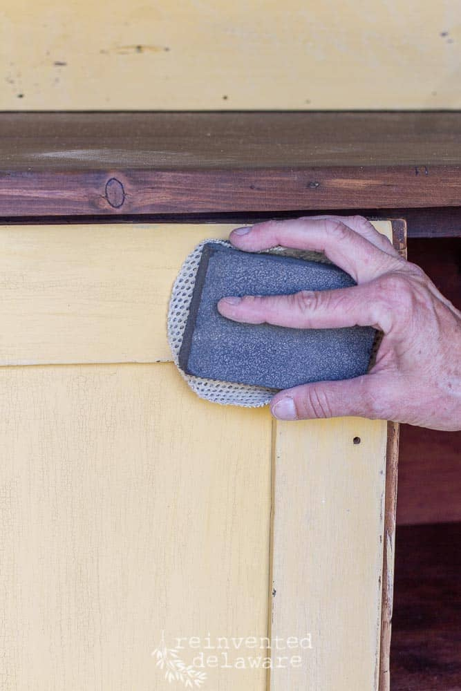 distressing antique pine cupboard by sanding
