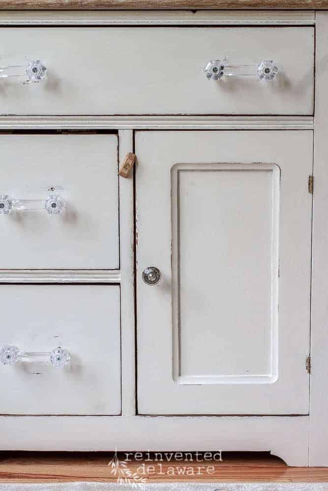 close up of glass drawer pulls on vintage washstand makeover
