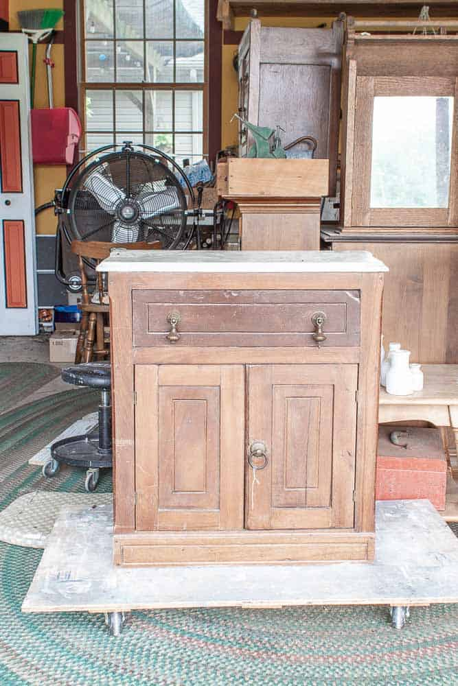 antique washstand before furniture makeover with milk paint