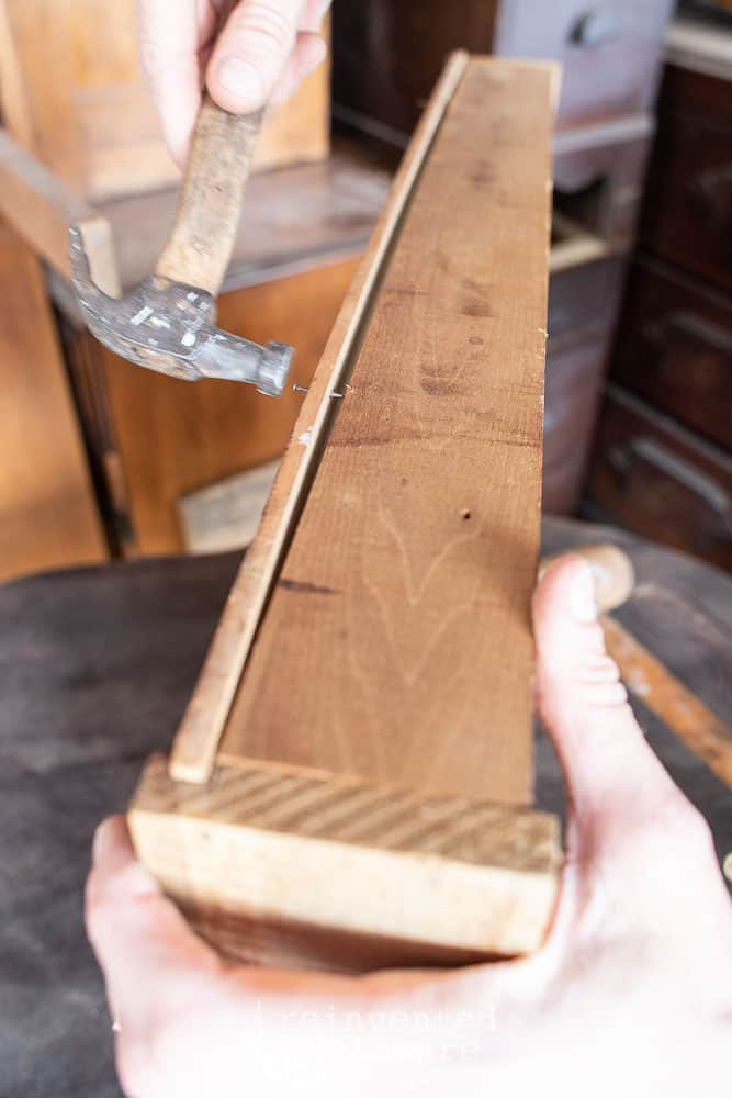 minor repairs being made on antique oak fold down desk drawer