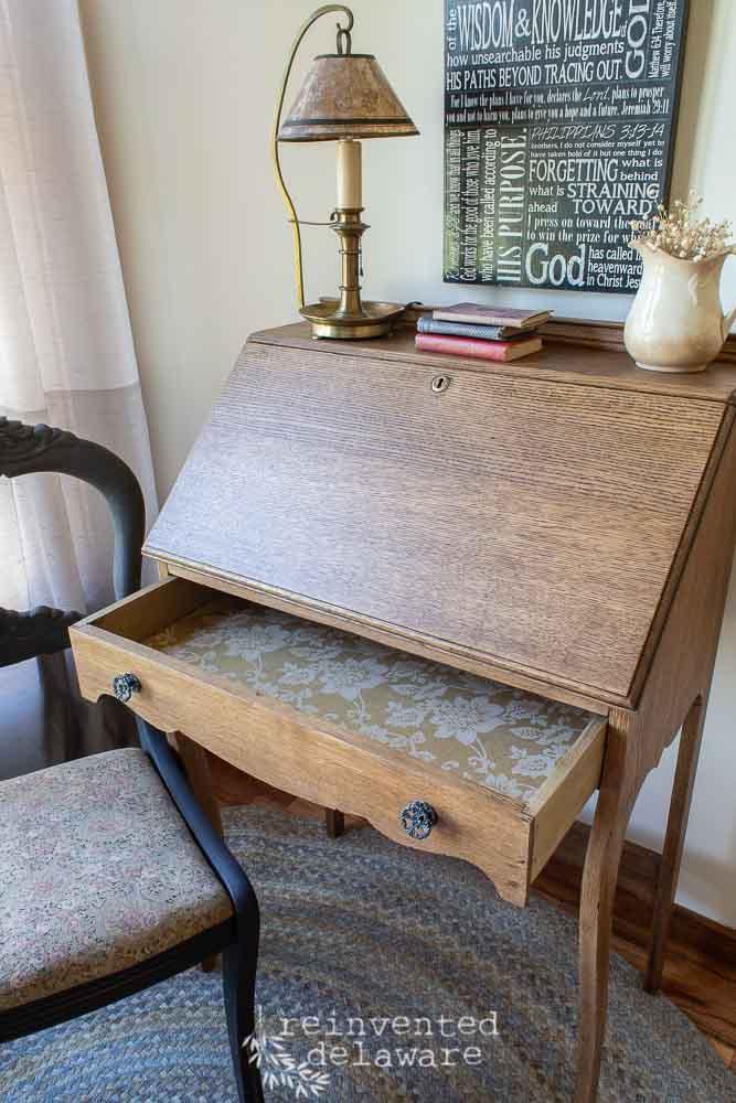 antique oak fold down desk showing interior of lined drawer