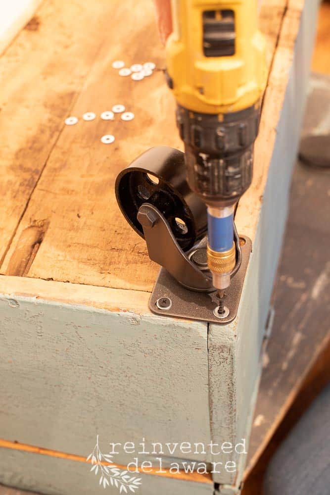 attaching spray painted casters to old wooden tool box