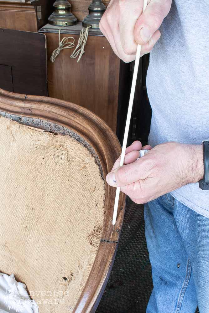 Want to know how to reupholster an antique settee that if broken? In this post, I will teach you how to make the repairs needed to restore this antique! #antiquefurniture #reupholster #restoredfurniture