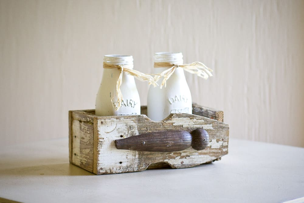 diy picket crate with 2 painted milk bottles
