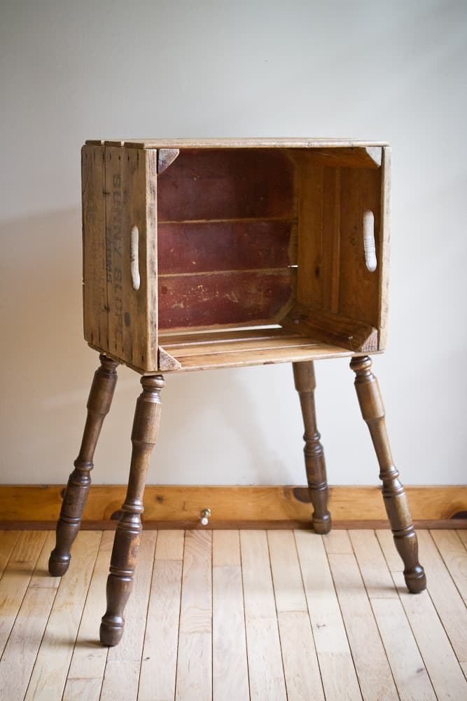 vintage fruit crate with spindle legs added to create a side table