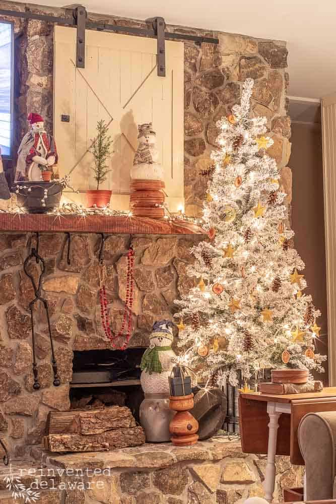 living room fireplace mantle and flocked Christmas tree