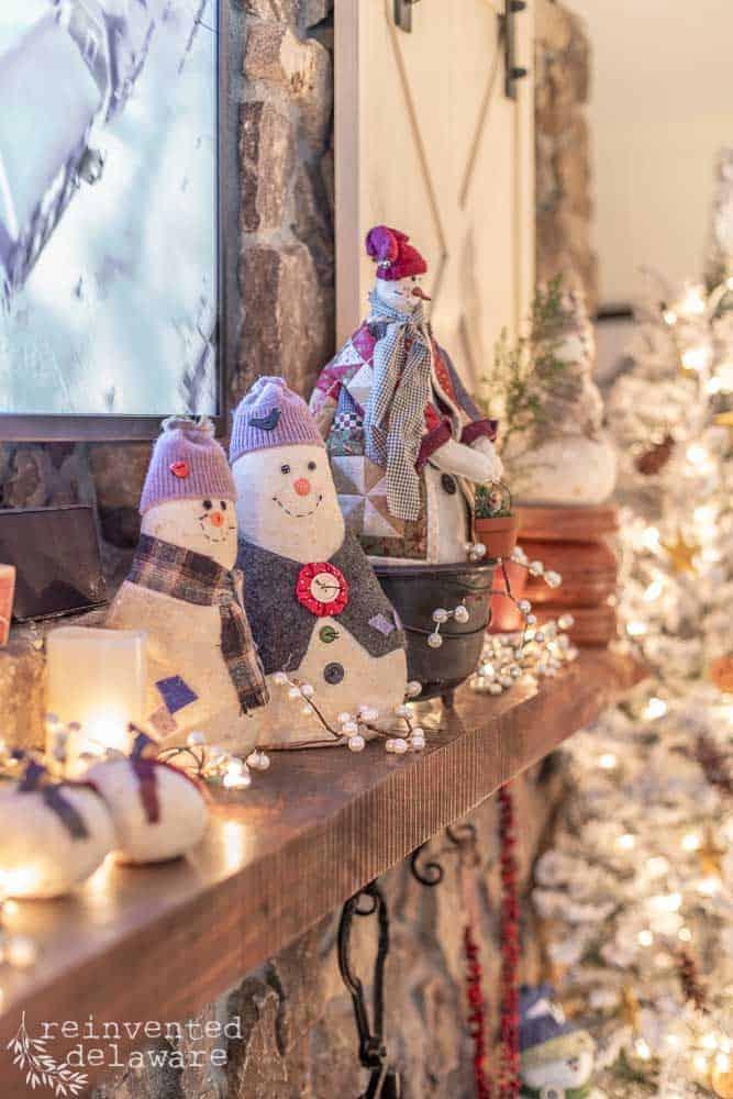 fireplace mantel with handmade snowmen sitting on top