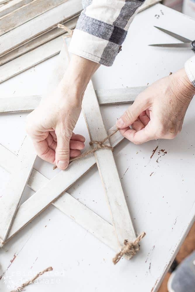 using jute twine to secure section on handmade farmhouse style stars