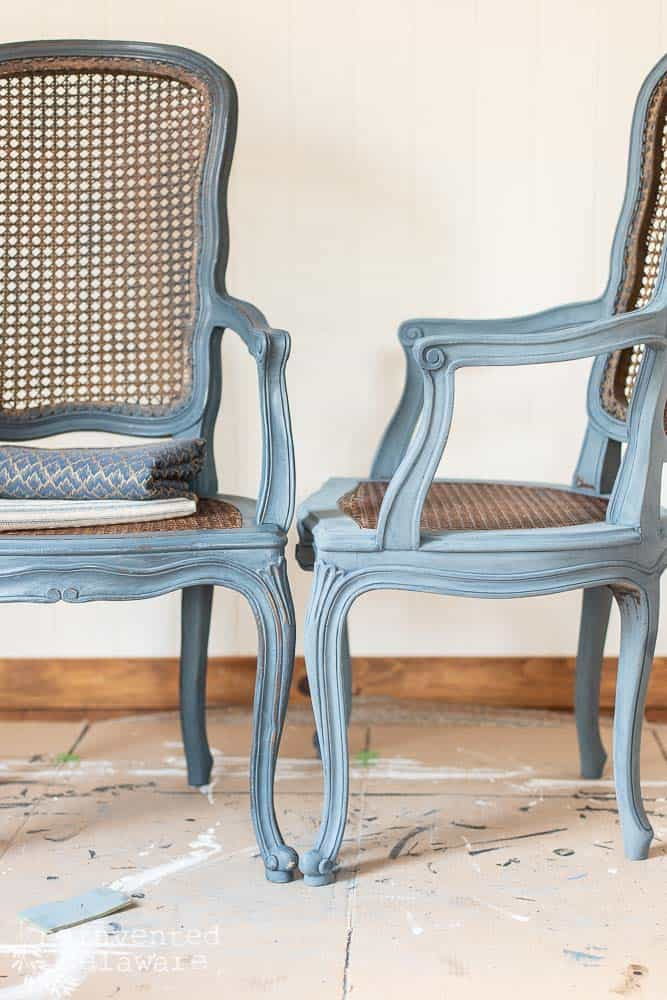 pair of painted caned chairs, one waxed and one not yet waxed