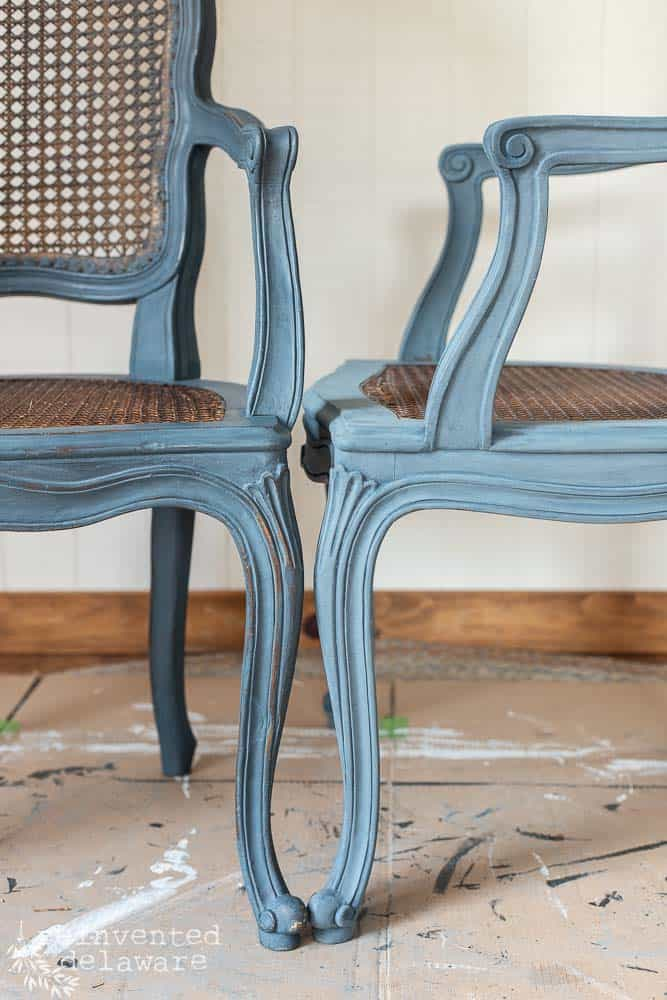 close up of painted caned chairs showing difference with wax finish on one