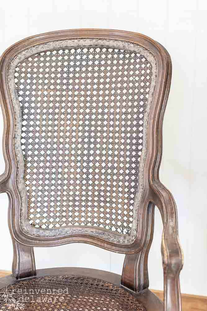 close up of caned chairs showing torn caning removed on back section