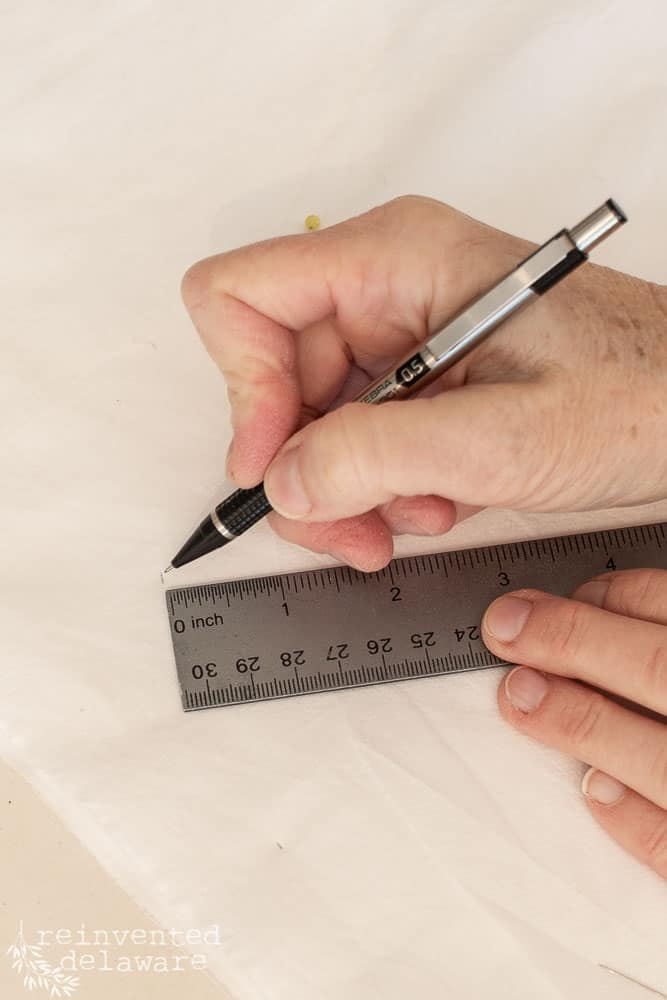 pencil and ruler being used to make pattern for seat cushion