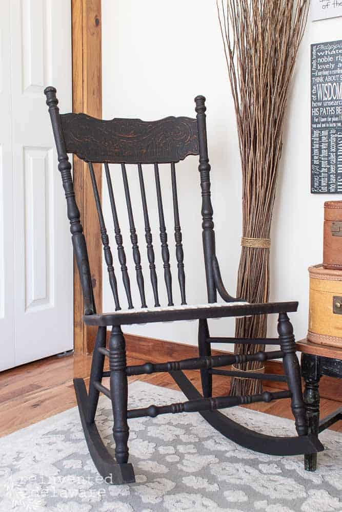 finished black rocker with repair 'caned' seat using clothesline rope