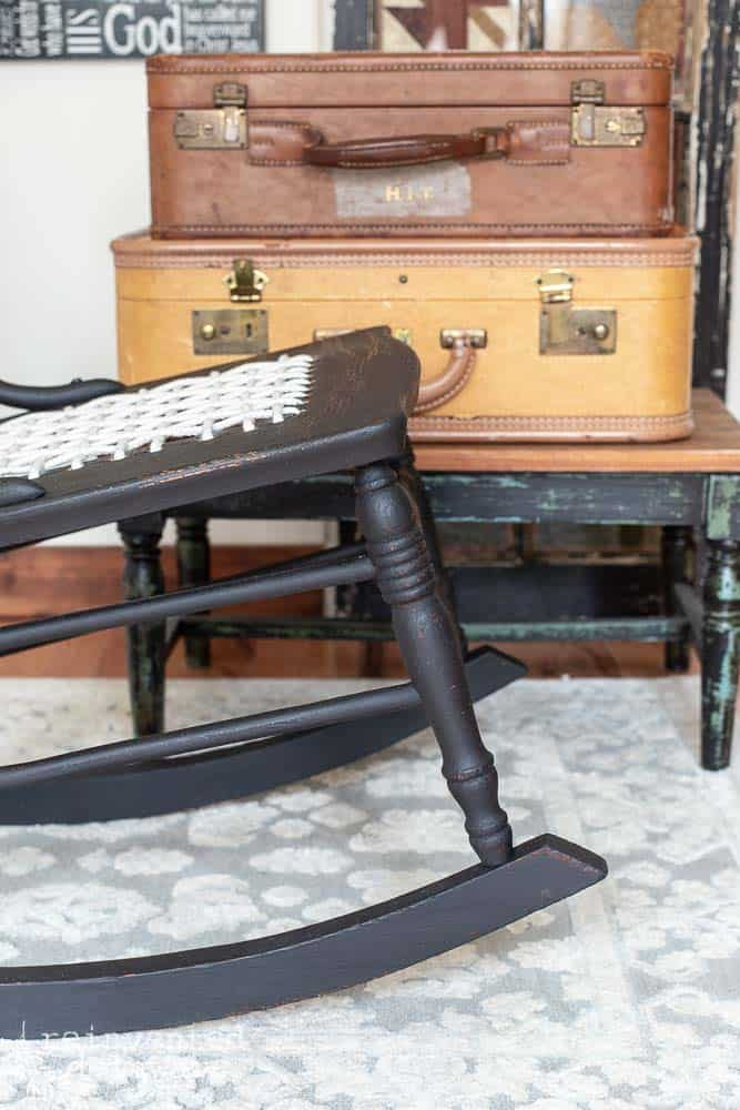 finished black rocker painted in Miss Mustard Seed Milk Paint in Typewriter black close up of spindle details