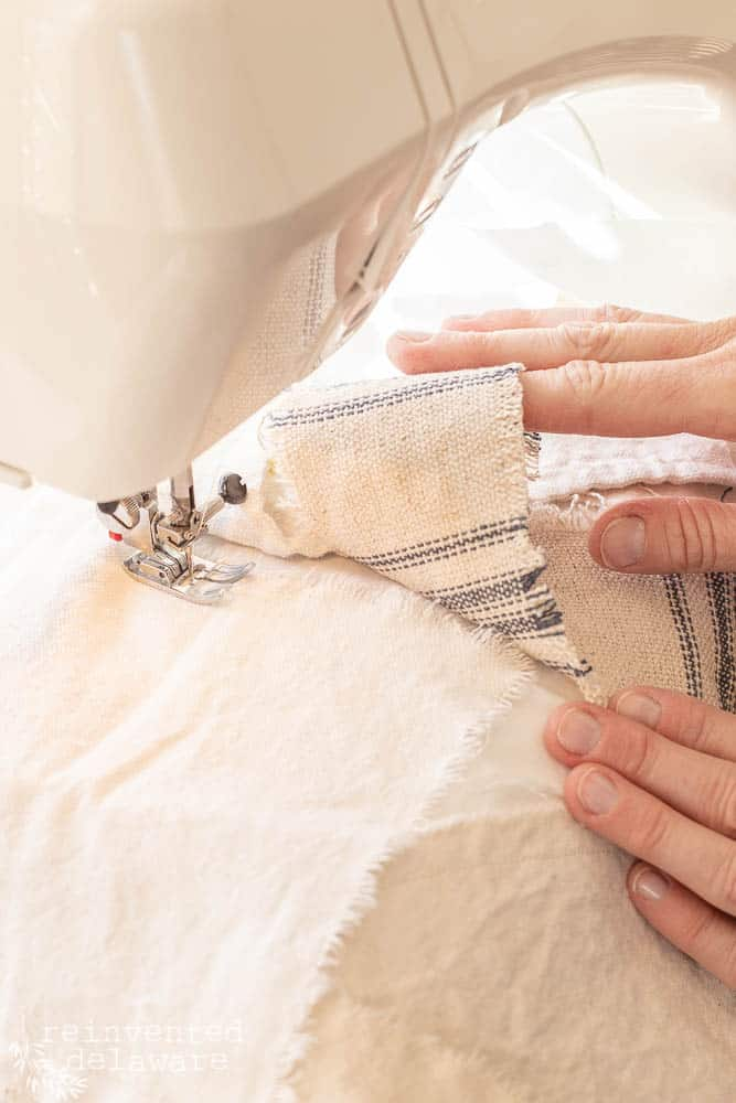 woman showing how to sew fabric scrapes together for chair makeover