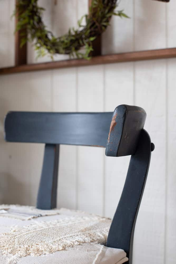 close up of blue painted areas on vanity chair