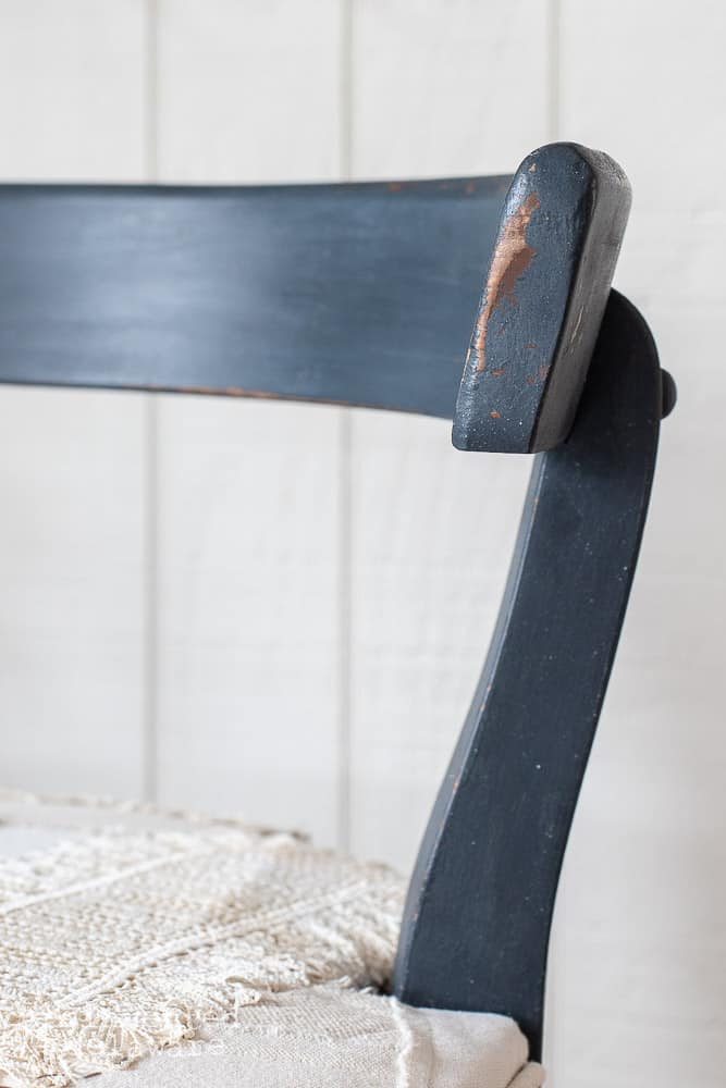 close up of blue vanity chair showing chippy details
