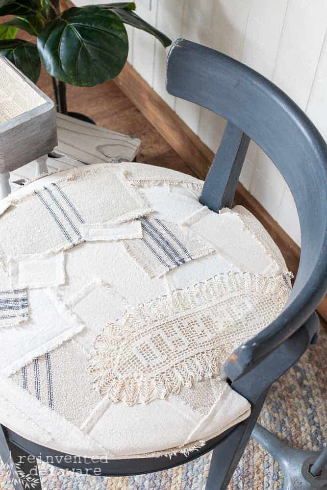 close up of patchwork style chair seat sewn with scraps of fabric