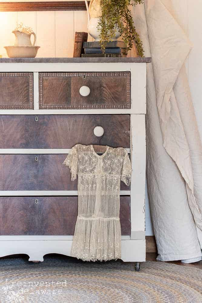 mahogony dresser makeover with childs lace dress hanging from drawer pull