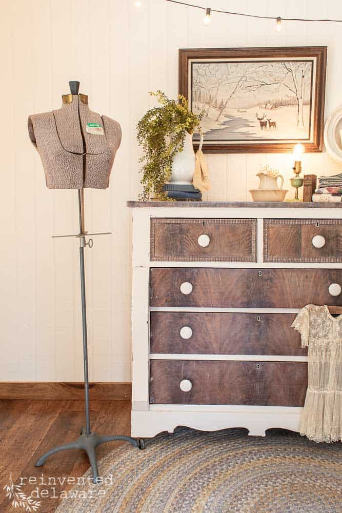 partial view of dresser makeover with antique dress form, wall decor and table top decor