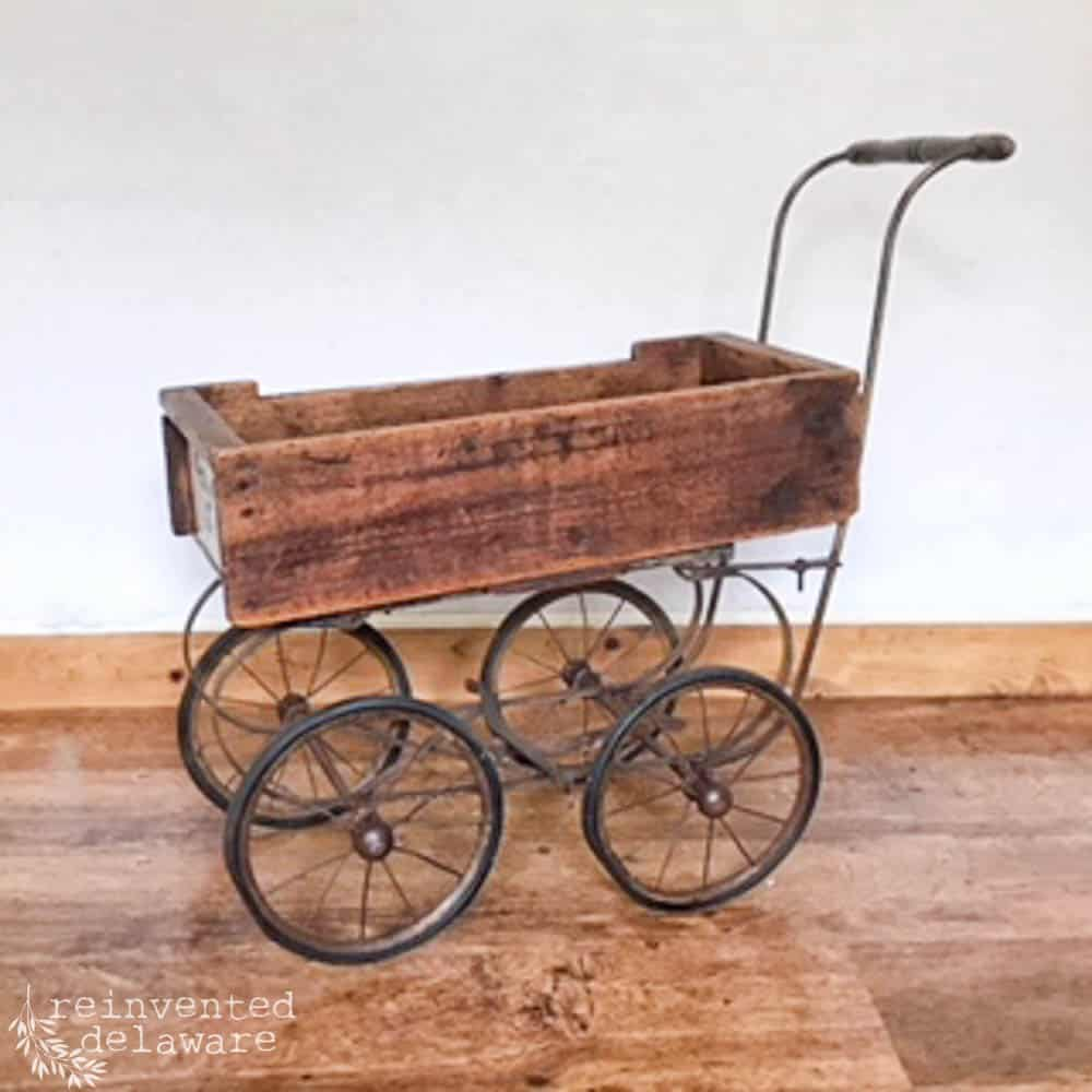 reinvented wood box attached to vintage baby stroller