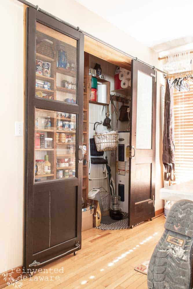 full view of pantry in laundry room with sliding barn doors