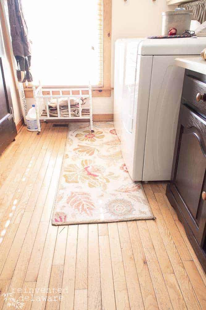 dirty rug on laundry room wood floor