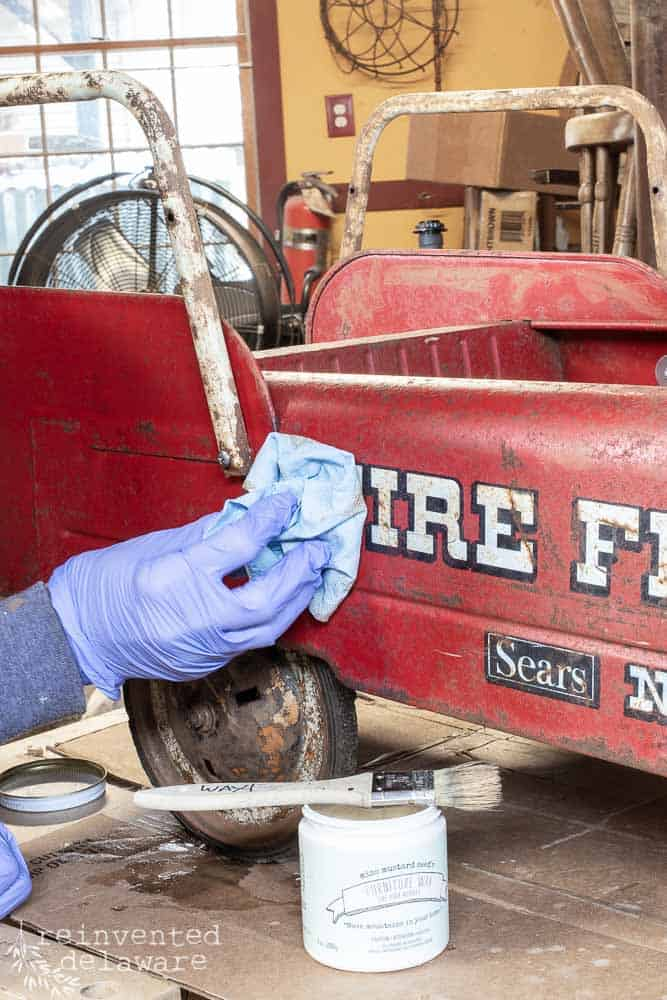 side view of toy firetruck with wax being buffed off