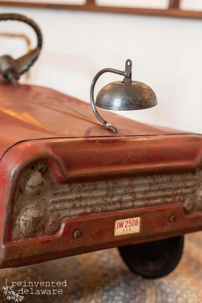 close up of bell on front of antique toy fire truck