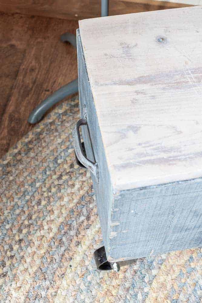 repurposed wooden toolbox showing original handle on side