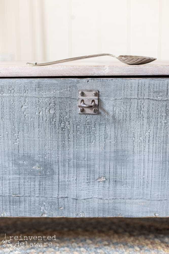 close up of original lock on vintage wood toolbox