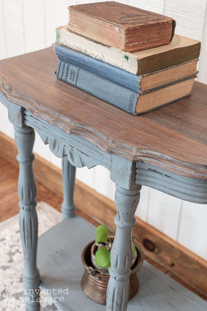close up of white waxed top on Demilune Table makeover