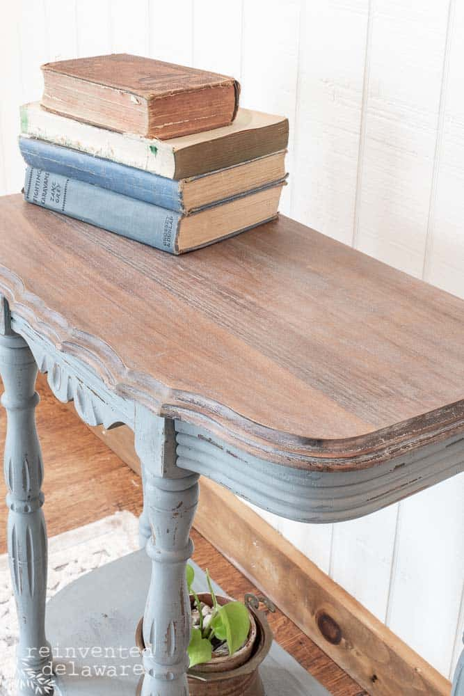 close up of Demilune table makeover with white waxed top