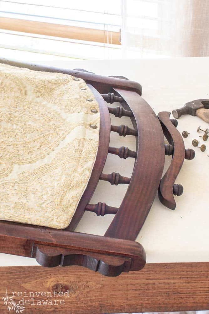 detail of decorative nail heads on rocking chair upholstery, Eastlake rocking chair