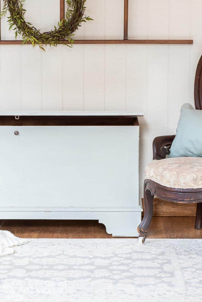 close up of one side of blanket chest from a furniture prep and painting blog post