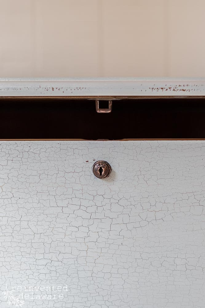 close up of lock on 19080s blanket chest that was painted