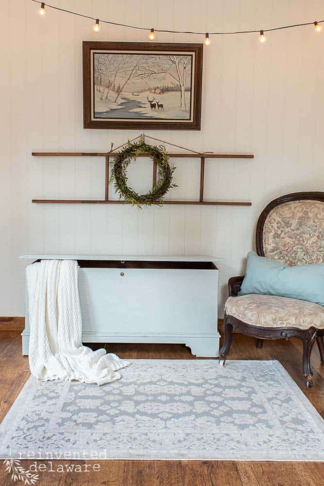 blanket chest after being painted in Miss Mustard Seed Milk Paint Mora staged with home decor