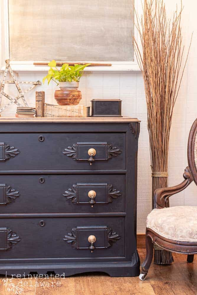 side view of antique gentlemen's dresser after being painted in MIss Mustard Seed Milk Paint in Typewriter black