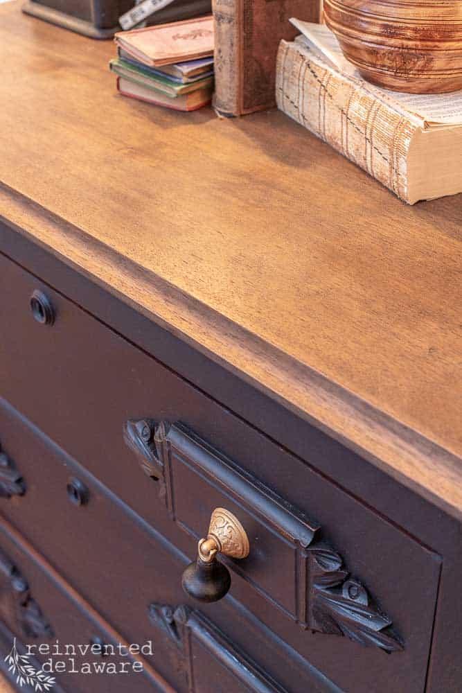 close up shot of restored wood top on gentlemen's dresser