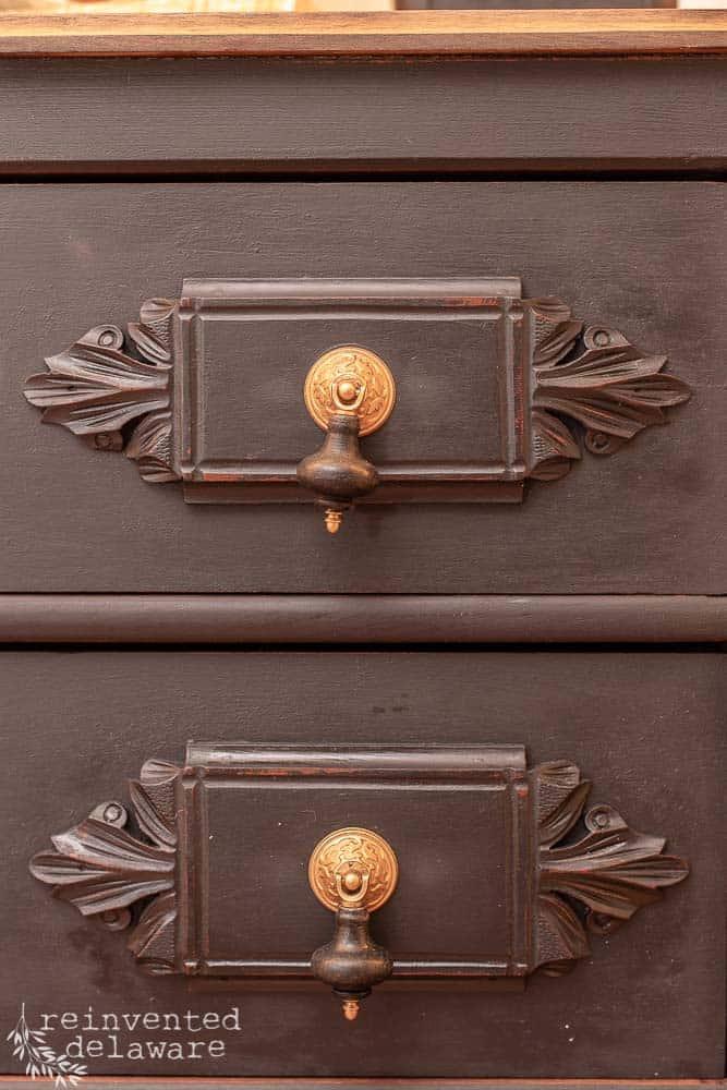 close up of two drawer pulls on restored antique gentlemen's dresser