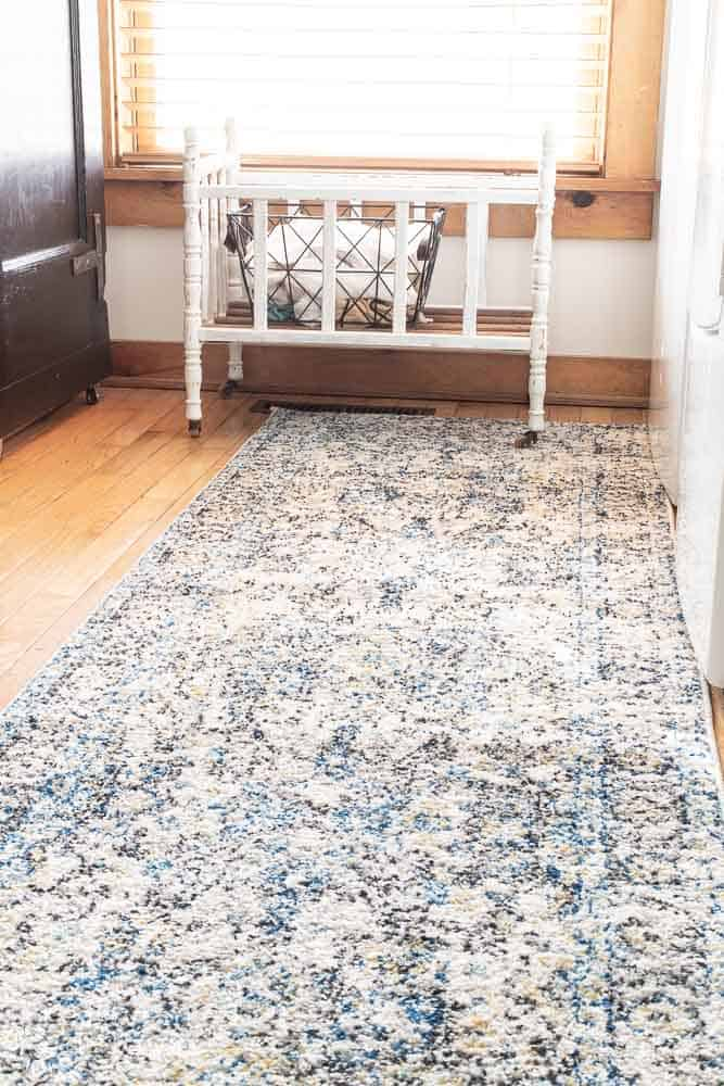 full view of Madison Safavieh rug in laundry room that measures 2'x8'