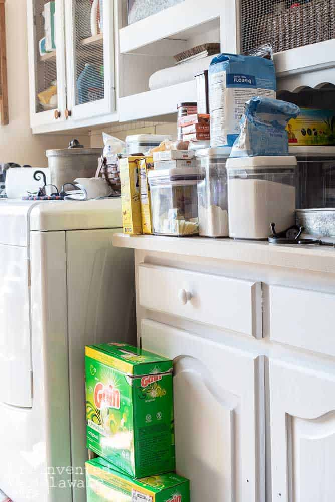 pantry items stacked on countertop in laundry room