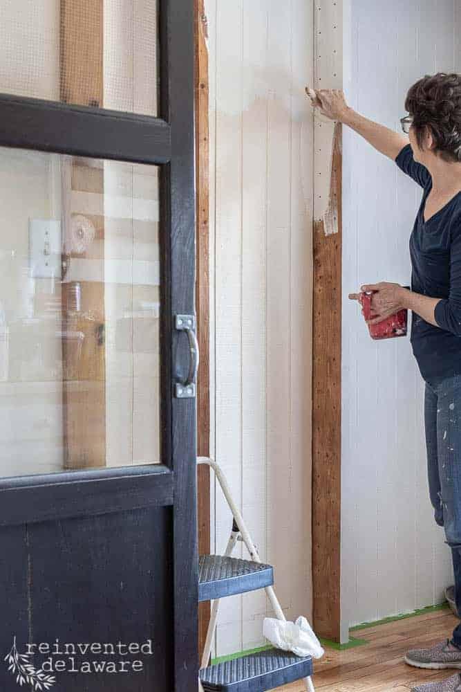 lady painting pantry shelves with Zibra paintbrush