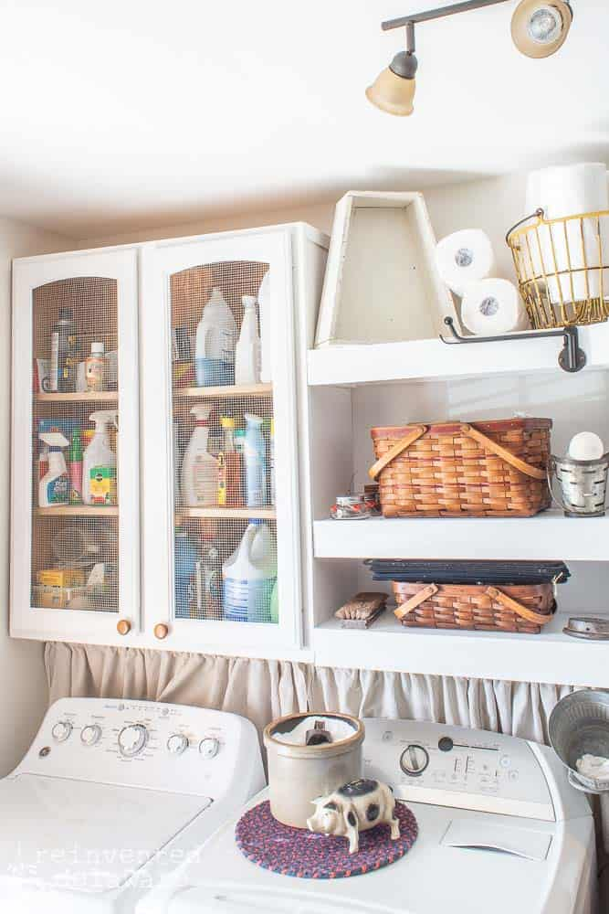 cabinets and shelves in a functional laundry room
