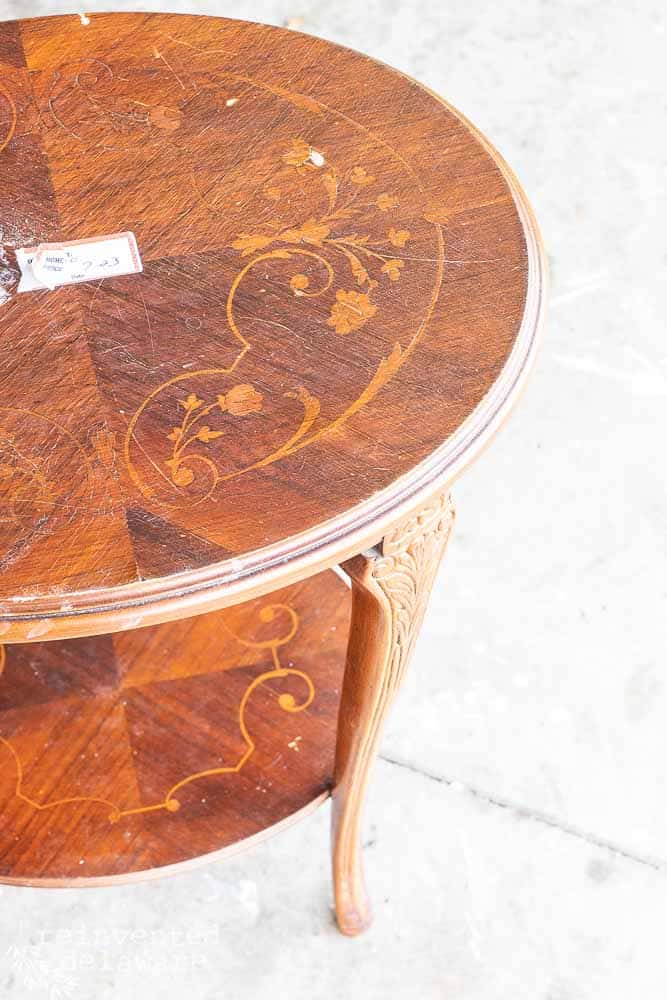 vintage side table with wood inlay showing top before restoration of furniture